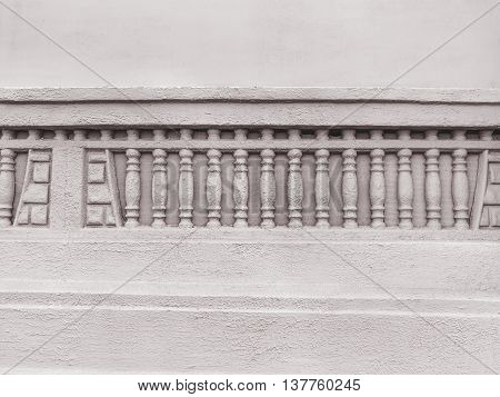 Background An Old Cement Wall With Bas-relief Of The Classic Columns. As A Creative Background For D