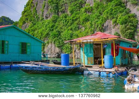 Floating fishing village near mountain islands in Halong Bay Vietnam Southeast Asia