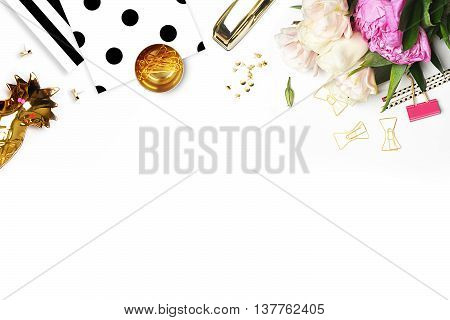 Flat lay. Flower on the table. Gold pineapple.Table view. Mock-up background. Peonies flower. Polka dots pattern. Mockup product view table gold accessories. stationery supplies. glamour style.