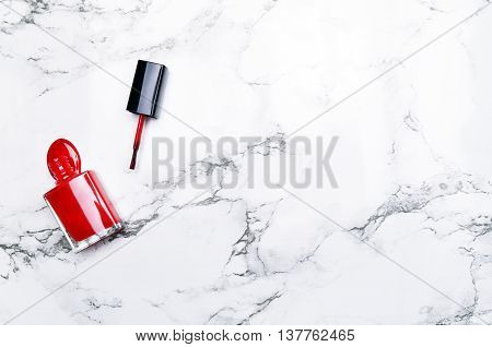 Marble Background with red lacquer. Fashion background. Woman items. View table. Flat lay. Mockup background