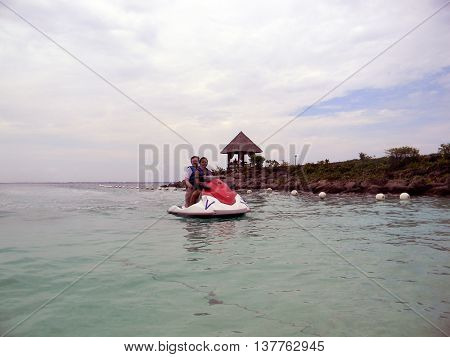 LAPU LAPU, CEBU / PHILIPPINES - JULY 28, 2011: People return to the beach from a ride in a jet ski at Shangri-La's Mactan Resort and Spa.