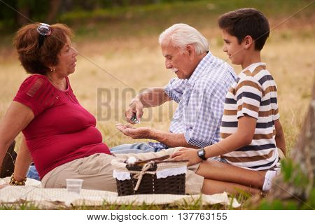Old Man Grandpa With Family Taking Medicine Pill For Heart