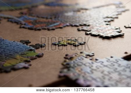 Partially completed color puzzle on table closeup