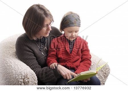 Mother And Little Girl Reading A Story