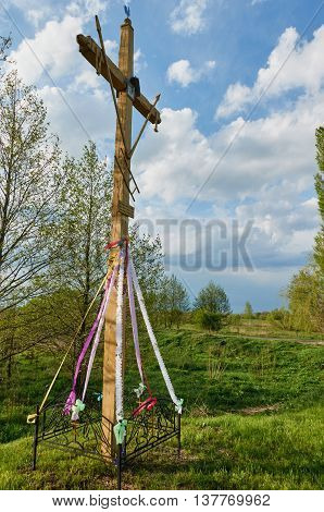 Cross in field travel photo. religion worship Christmas Easter thanksgiving prayer and praise.