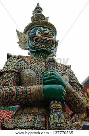 Giant yaksha demon guardian statue at the historic Grand Palace in Bangkok, Thailand