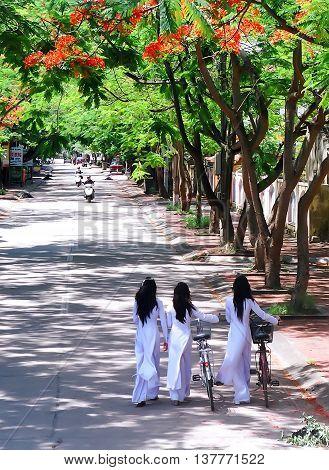 HAI PHONG, VIETNAM, June 24, 2016 group of girls, Hai Phong, dressed in a long coat, walking on the road more flamboyant, summer