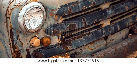 Front view of rusty abandoned truck. Color-toning applied
