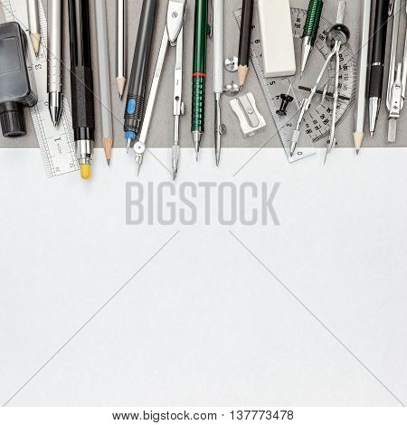 Blank Paper Sheet With Pens And Pencils, Drawing Compass, Protractor, Eraser, Sharpener