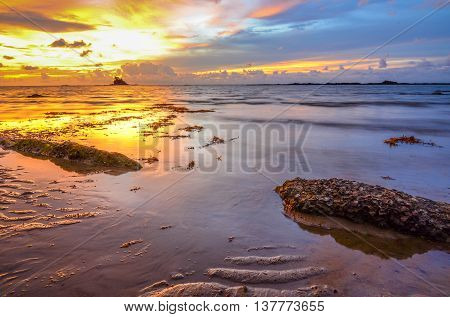 Puddles low tide with twilight beautiful sunset tropical beach island at Labuan Pearl of Borneo,Malaysia.