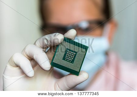 Scientist Showing The Computer Microchip Before Repairs Electron