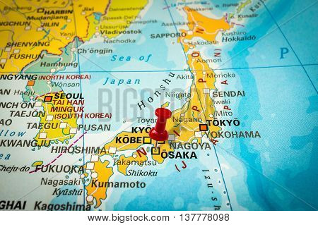 Red Thumbtack In A Map, Pushpin Pointing At Osaka