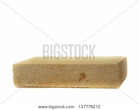 a freshly cut block of wood. Edges on the wood are rough. Wood is isolated on a white background.