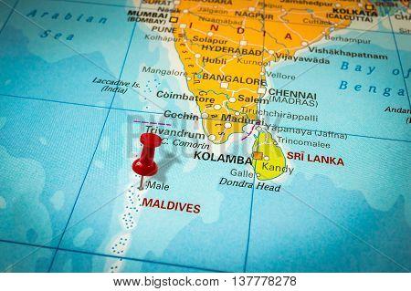 Red Thumbtack In A Map, Pushpin Pointing At Maldives