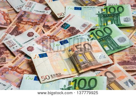Russian And Euro Banknotes Background