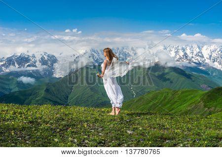 Snowy Mountains And Beautiful Dancing Girl In Georgia