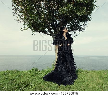 Fashion woman posing near the sea. Dark Queen.