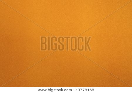 Texture of dense cardboard with yellow velvety coating