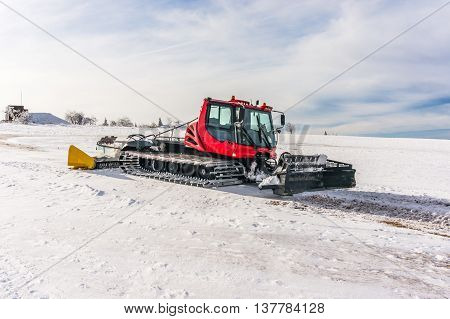 Red Snow-grooming Machine On Snow