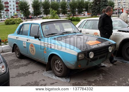 PERM RUSSIA - JUNE 29 2016: Rally of retro-cars Peking-Paris 2016 June 29 2016 in Perm Russia. Cars are in the city after the next stage.