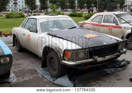 PERM RUSSIA - JUNE 29 2016: Rally of retro-cars Peking-Paris 2016 June 29 2016 in Perm Russia. Mercedes 450 SLC is in the city after the next stage.