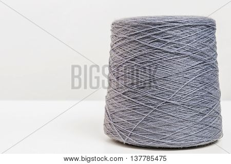 Hank Of Gray Woolen Threads Closeup On A White Background