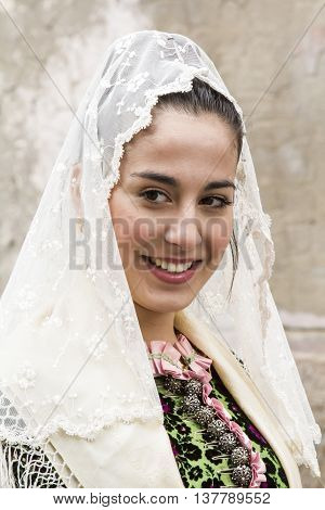 CAGLIARI, ITALY - May 1, 2016: 360 ^ Sant'Efisio Festival - Sardinia - portrait of a beautiful girl in traditional Sardinian costume