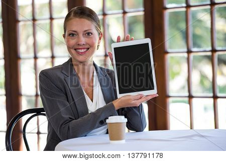 Woman presenting a tablet in a restaurant