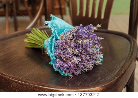 Lavender bouquet on chair.