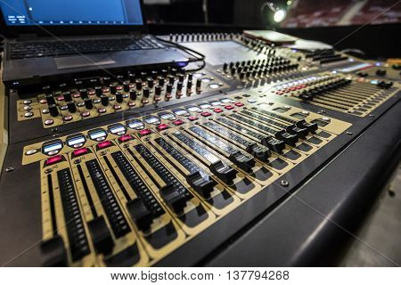 Professional sound music mixer control panel and laptop