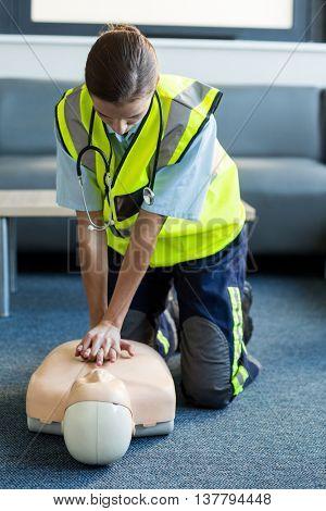 Female paramedic during cardiopulmonary resuscitation training in hospital