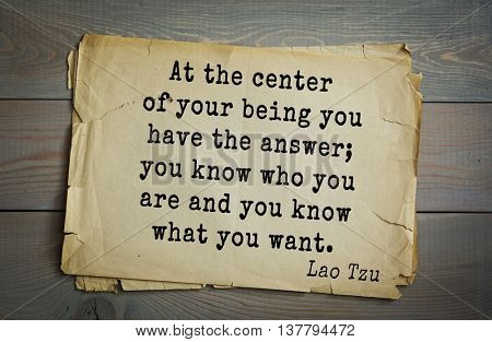 Ancient chinese philosopher Lao Tzu quote on old paper background. At the center of your being you have the answer; you know who you are and you know what you want.