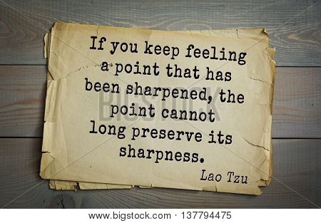 Ancient chinese philosopher Lao Tzu quote on old paper background. If you keep feeling a point that has been sharpened, the point cannot long preserve its sharpness.