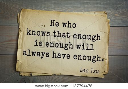 Ancient chinese philosopher Lao Tzu quote on old paper background. He who knows that enough is enough will always have enough.