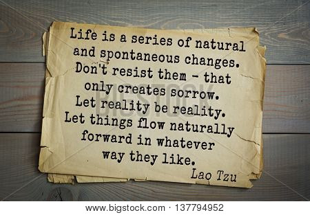 Ancient chinese philosopher Lao Tzu quote on old paper background. Life is a series of natural and spontaneous changes. Don't resist them - that only creates sorrow. Let reality be reality.
