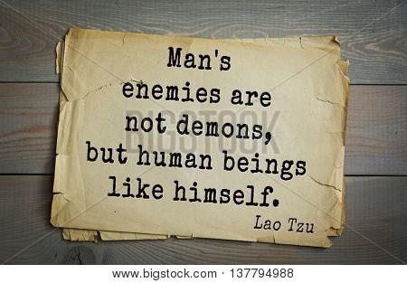 Ancient chinese philosopher Lao Tzu quote on old paper background. Man's enemies are not demons, but human beings like himself.