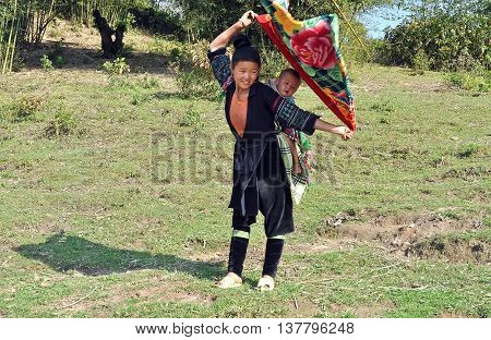 SAPA. VIET NAM, February 12, 2016 the mother and children, ethnic Hmong, highland Sapa, Vietnam. carried you on his back