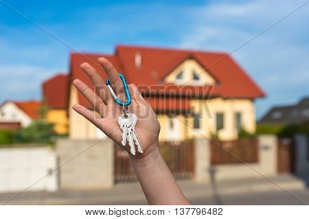 Real Estate Agent Giving House Keys To A New Property Owner