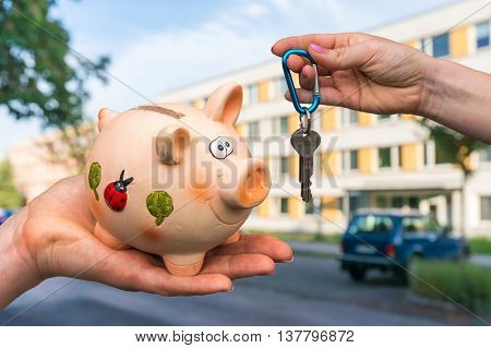 Real Estate Agent Giving Home Keys To A New Property Owner, Who
