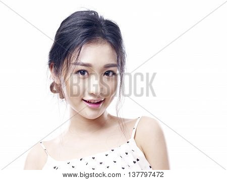 young and beautiful asian woman in pajamas looking at camera isolated on white background.