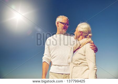 family, age and people concept - happy senior couple talking outdoors