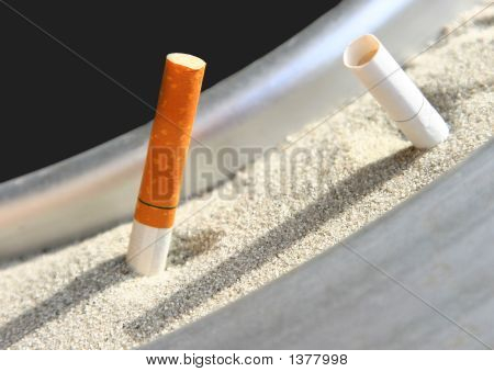 Cigarette Butts Put Out In Ashtray
