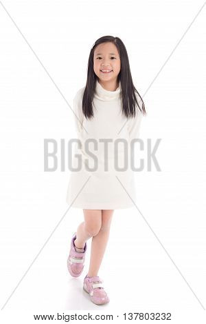 Cute asian girl in white turtleneck dress on white background isolated
