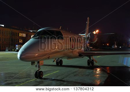 Kiev Ukraine - March 27 2011: Business jet parked on the apron at night