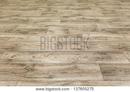 Linoleum flooring with embossed wood texture. Dark brown floor. Horizontal layout perspective.