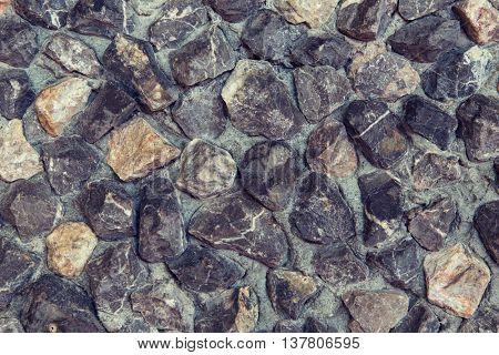 design and texture concept - grainy stone decorative tile background