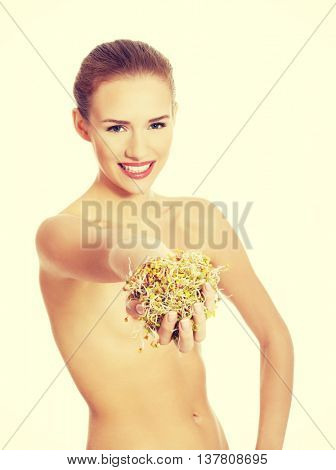 Beautiful woman with fresh green cress.