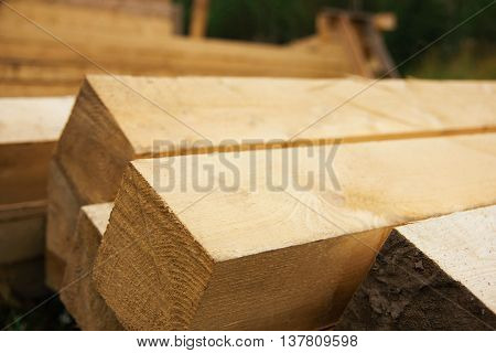timber lumber laid on the street in summer