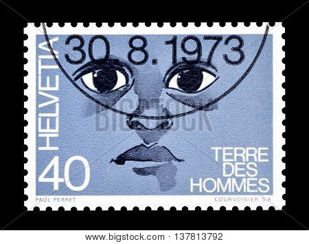 SWITZERLAND - CIRCA 1973 : Cancelled postage stamp printed by Switzerland, that shows Face of the child.