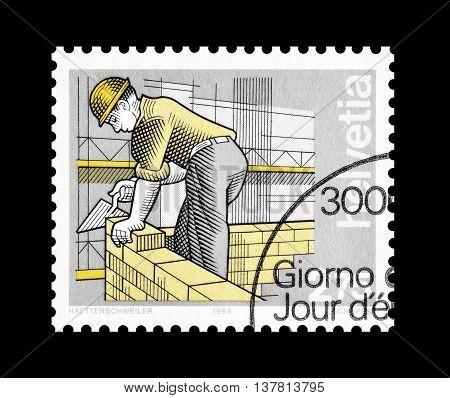 SWITZERLAND - CIRCA 1989 : Cancelled postage stamp printed by Switzerland, that shows Bricklayer.
